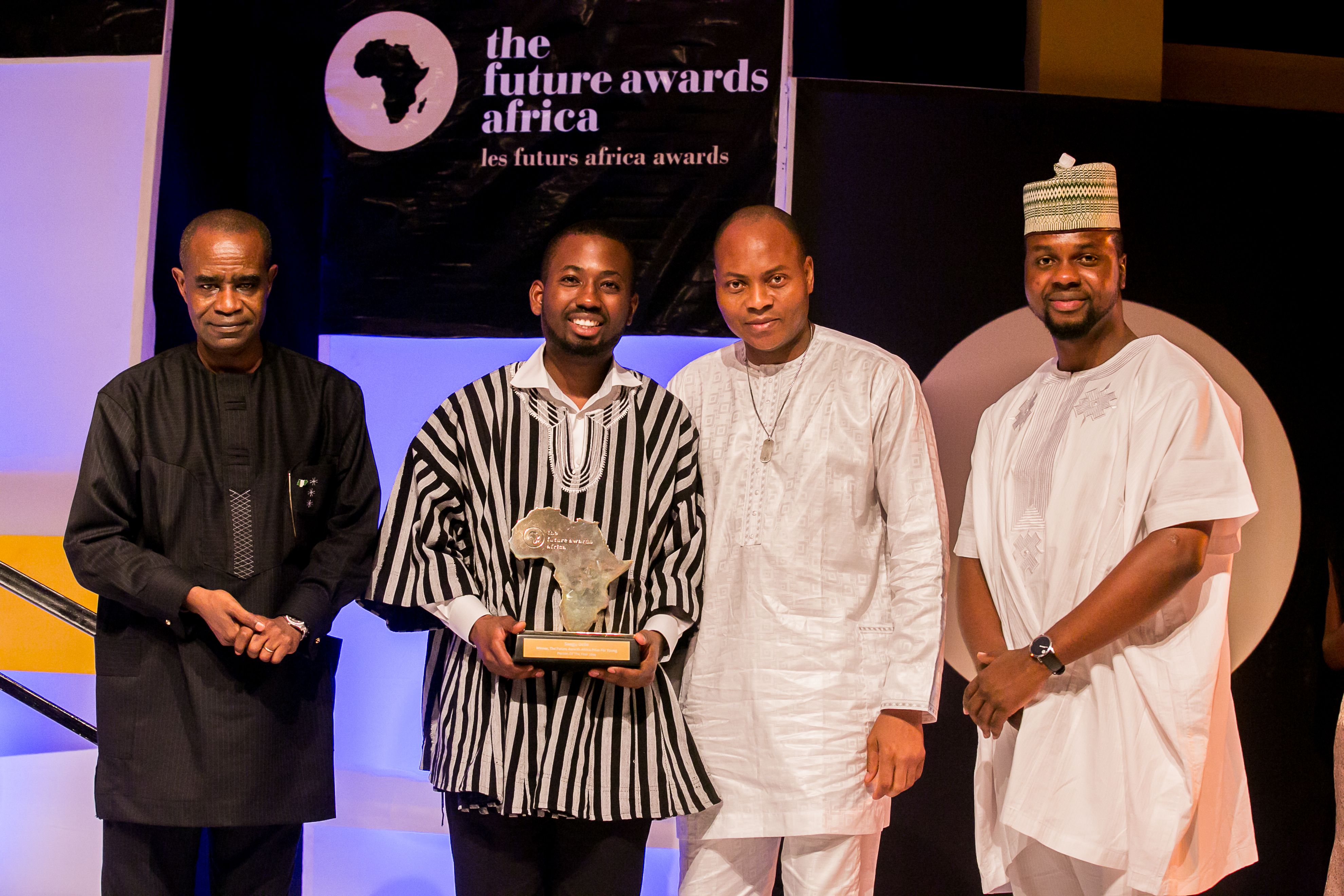 Winner, TFAA2014 Young Person of the year with Mr. Boni Haruna, Minister for Youth Development,  Director from UBA at the event and Adebola Williams